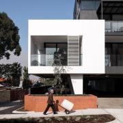 This white 'block' draws the eye architecture, building, condominium, facade, house, residential area, black