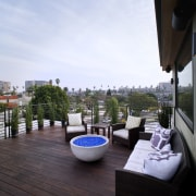 A rooftop deck is the perfect place to apartment, balcony, home, outdoor structure, penthouse apartment, property, real estate, resort, roof, white, black