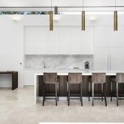 Tall order – this kitchen achieves drama through chair, floor, flooring, furniture, interior design, table, wall, white