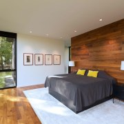 The use of wood in the bedroom – architecture, bed frame, bedroom, ceiling, estate, floor, flooring, hardwood, home, house, interior design, living room, property, real estate, room, wall, wood, wood flooring, brown, gray