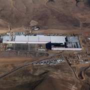 Construction underway on the Gigafactory aerial photography, bird's eye view, mining, black, brown