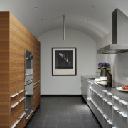 Wood cabinets and drawers face the countertop architecture, ceiling, daylighting, floor, flooring, interior design, gray