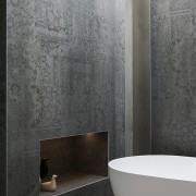 A disused fireplace alcove was retained in the bathroom, bidet, ceramic, floor, flooring, interior design, plumbing fixture, room, tap, tile, wall, gray, black