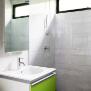 A lime green floating vanity sits alongside the bathroom, bathroom accessory, bathroom cabinet, bathroom sink, floor, interior design, plumbing fixture, product design, room, sink, tap, tile, wall, white, gray