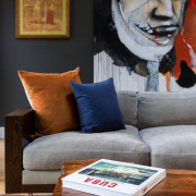 The interior design certainly comes together to create chair, couch, dog, furniture, home, table, gray, black