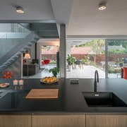 The kitchen flows into the dining space and architecture, countertop, house, interior design, kitchen, real estate, gray