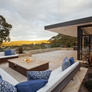 This three-level home takes in spectacular views of architecture, estate, home, house, interior design, outdoor structure, patio, property, real estate, white
