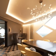 The window is certainly the eye-catching feature in ceiling, interior design, lighting, living room, room, wall, orange