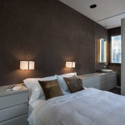 A unique headboard features shelf space and drawers architecture, bedroom, ceiling, floor, home, interior design, property, real estate, room, wall, gray, black