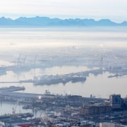 The Zeitz Museum of Contemporary Art Africa (Zeitz aerial photography, bird's eye view, calm, city, cloud, coastal and oceanic landforms, daytime, fog, haze, horizon, inlet, mist, morning, river, sea, sky, skyline, water, water resources, white, gray