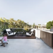 The rooftop garden is private and sunny architecture, furniture, house, outdoor structure, property, real estate, roof, table, white