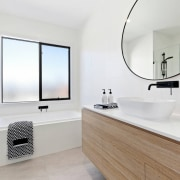 A large circular mirror draws the eye in bathroom, bathroom accessory, bathroom cabinet, interior design, product design, room, sink, white, gray