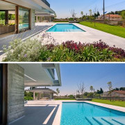 The pool area is large, spacious and compliments estate, grass, home, house, leisure, property, real estate, residential area, roof, swimming pool, water, teal