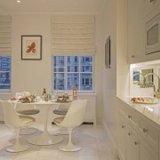The updated kitchen doesn't entirely leave the past dining room, floor, flooring, furniture, home, interior design, kitchen, living room, real estate, room, table, wall, window, orange, brown
