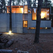 Substantial windows provide views out to the forest home, house, lighting, real estate, tree, black