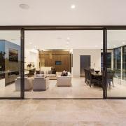 On this top floor of a three-level Sydney door, floor, flooring, house, interior design, lobby, real estate, window, gray