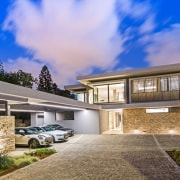 The stone featured in the parking area and architecture, building, elevation, estate, facade, family car, home, house, property, real estate, residential area, roof, sky, villa, blue