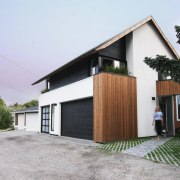 Using a number of materials results in an architecture, facade, home, house, property, real estate, residential area, white