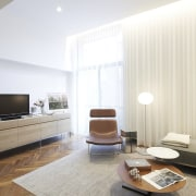 The lounge is spacious, full of light and ceiling, floor, interior design, interior designer, living room, property, real estate, room, wall, white