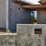 Concrete, glass and timber are themes established before architecture, building, facade, home, house, residential area, sky, wall, window, gray