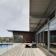 Corrugated steel runs along the roof architecture, daylighting, deck, facade, house, gray, white, black