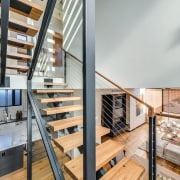 The stairway is a centrepiece for the living handrail, interior design, loft, real estate, stairs, gray