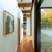 This hallway doesn't lack for light, with both ceiling, floor, flooring, house, interior design, gray