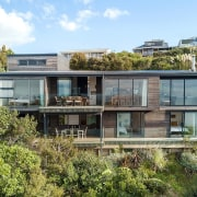 The home has spectacular sea views, thanks to architecture, building, cottage, elevation, estate, facade, home, house, neighbourhood, property, real estate, residential area, villa, brown