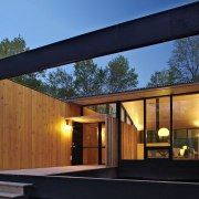 The front entrance is sheltered and adds privacy architecture, facade, home, house, real estate, siding, wood, black