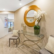 This round mirror is undeniably the centre of ceiling, home, interior design, real estate, room, suite, gray