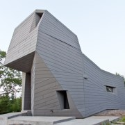 The rotating structure in the default position architecture, barn, building, facade, home, house, siding, white, gray