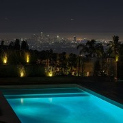 The city takes on a whole other quality estate, evening, landscape lighting, light, lighting, night, reflection, sky, swimming pool, water, black