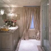 Elegant fittings line this bathroom bathroom, ceiling, curtain, floor, flooring, home, interior design, room, textile, wall, window, window covering, window treatment, gray