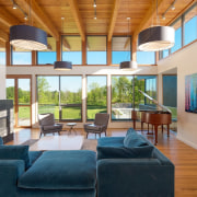 Clerestory windows wrap around the living room, while architecture, ceiling, daylighting, estate, house, interior design, living room, real estate, window, gray