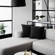 This apartment is as much about the fittings black and white, coffee table, couch, furniture, home, interior design, living room, product design, table, white, black