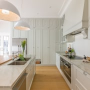 Plentiful storage on the far wall ceiling, countertop, cuisine classique, interior design, kitchen, real estate, gray