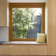 Shelves and drawers run around this window seat door, floor, hardwood, home, interior design, living room, wall, window, window covering, wood, wood flooring, brown, gray