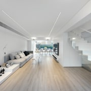 It's a long home, with a clear corridor architecture, ceiling, floor, flooring, interior design, gray