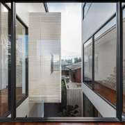 Expansive, wraparound glass means light and views into architecture, building, condominium, daylighting, door, glass, handrail, house, interior design, property, real estate, stairs, window, gray