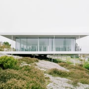The home exemplifies the best of Swedish design. architecture, corporate headquarters, house, white