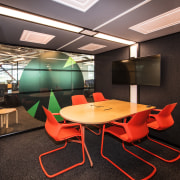 Much like the B:HIVE's open office floors, the architecture, ceiling, chair, conference hall, furniture, interior design, office, table, black