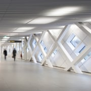 This hallway certainly echoes the airport terminal aesthetic architecture, ceiling, daylighting, floor, interior design, product design, structure, tourist attraction, gray