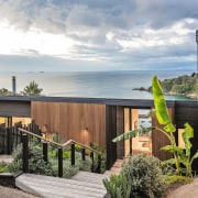 A gorgeous outlook to the ocean architecture, cottage, facade, home, house, outdoor structure, property, real estate, gray