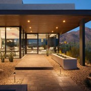 This entrance is certainly inviting architecture, backyard, estate, home, house, interior design, lighting, patio, property, real estate, brown