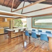 The kitchen/dining area open to the elements architecture, ceiling, daylighting, dining room, floor, flooring, hardwood, house, interior design, real estate, roof, table, wood, wood flooring, white, orange