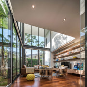 The extra high space opens the living room architecture, ceiling, condominium, daylighting, house, interior design, living room, lobby, mixed use, real estate, window, gray, brown