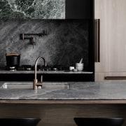 The splashback and countertop share materials bathroom, countertop, floor, flooring, interior design, tap, tile, wall, black, gray