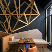 This geometric pattern extends out of the wall architecture, ceiling, daylighting, floor, furniture, hardwood, home, house, interior design, living room, loft, product design, table, wall, wood, wood flooring, black, brown
