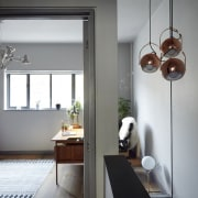 A wider view of the hallway home, house, interior design, light fixture, lighting, room, window, gray