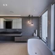 On this Davinia Sutton bathroom design, the cantilevered architecture, ceiling, estate, floor, flooring, home, house, interior design, real estate, wood flooring, gray